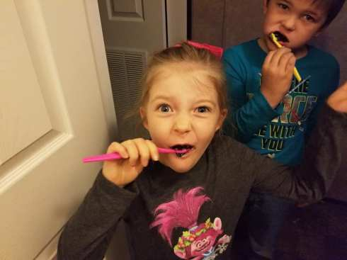 Madison brushing her teeth