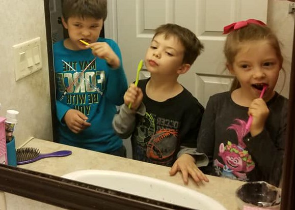 the kids brushing their teeth